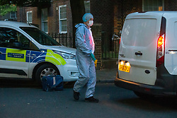 © Licensed to London News Pictures. 03/08/2020. London, UK. Police officers, forensics examiners at the scene of a shooting at Tilson Gardens, Brixton, that happened around 6.38pm on August 3rd, where a man was taken to hospital with a gunshot injury. Photo credit: Paul Davey/LNP