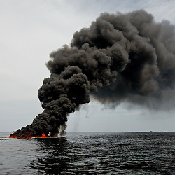 A controlled burn is seen near the source of the BP Plc Deep Water Horizon oil spill site in the Gulf of Mexico off the coast of Louisiana, U.S., on Thursday, July 15, 2010. Photographer: Derick E. Hingle/Bloomberg