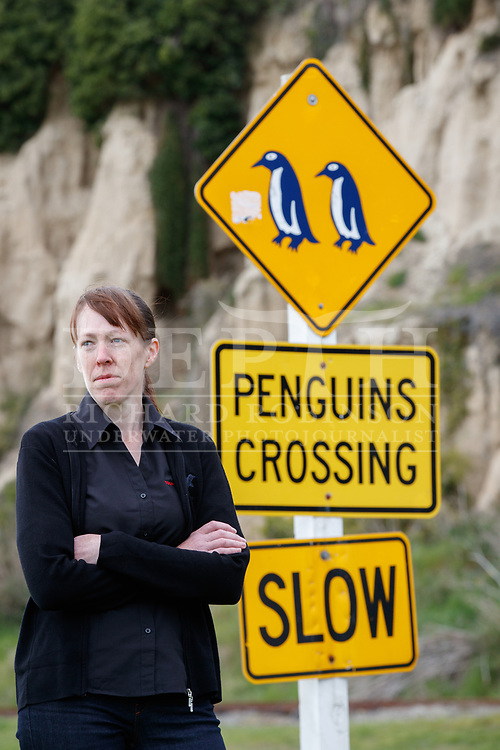 Blue Penguin Colony research scientist Philippa Agnew pictured a penguin crossing road sign near the tourist venture in Oamaru, New Zealand.<br /> 13 October 2016.<br /> Photograph Richard Robinson &copy; 2016