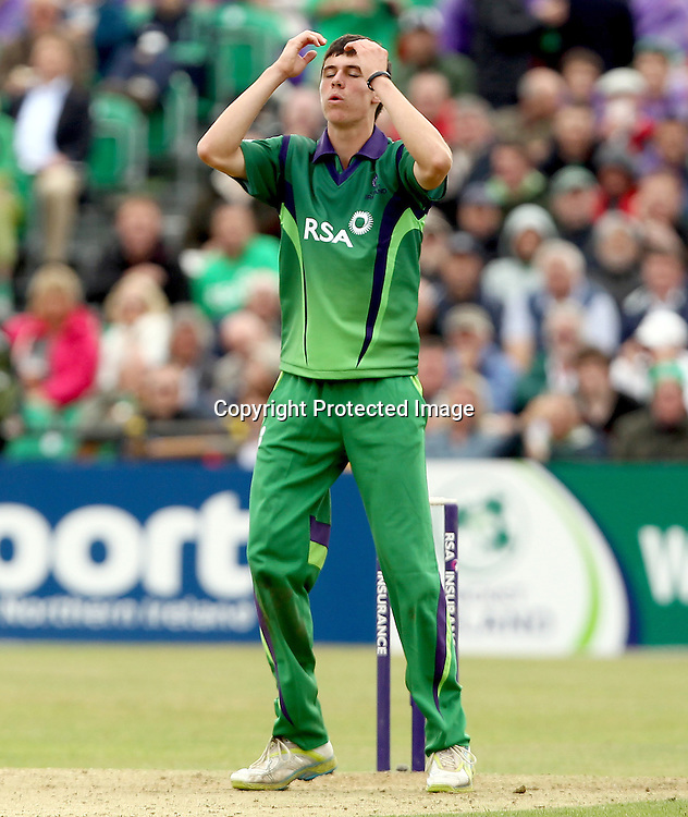 RSA Challenge ODI, Clontarf Cricket Club, Dublin, 25/8/2011<br />Ireland vs England<br />Ireland's George Dockrell reacts to conceding a boundary<br />Mandatory Credit &copy;INPHO/James Crombie  *** Local Caption ***
