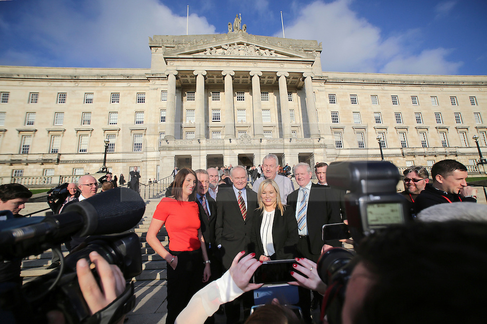© Licensed to London News Pictures. STORMONT BELFAST - 23 JAN 2017: Sinn Fein's Michelle O'Neill (centre) stands with Martin McGuinness and other Sinn Fein members on the steps of Stormont after being named as the politician who will take over from former deputy first minister Martin McGuinness who has retired due to illness.. Photo credit: London News Pictures.