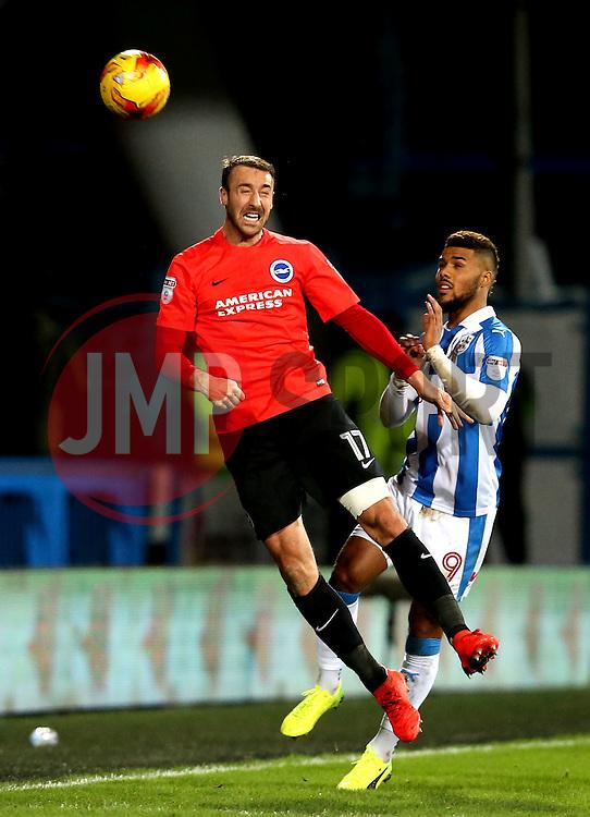 Glenn Murray of Brighton & Hove Albion heads the ball away from Sam Baldock of Brighton & Hove Albion - Mandatory by-line: Robbie Stephenson/JMP - 02/02/2017 - FOOTBALL - John Smith's Stadium - Huddersfield, England - Huddersfield Town v Brighton and Hove Albion - Sky Bet Championship