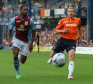 Picture by David Horn/Focus Images Ltd +44 7545 970036<br /> 23/07/2013<br /> Dave Martin (right) of  Luton Town and Janoi Donacien (left) of Aston Villa during the Pre Season Friendly match at Kenilworth Road, Luton.