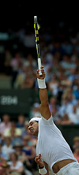LONDON, ENGLAND - Sunday, July 4th, 2010: Rafael Nadal (ESP) serves during the Gentlemen's Singles Final match on day thirteen of the Wimbledon Lawn Tennis Championships at the All England Lawn Tennis and Croquet Club. (Pic by David Rawcliffe/Propaganda)