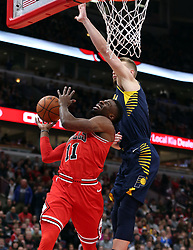 December 29, 2017 - Chicago, IL, USA - The Chicago Bulls' David Nwaba, left, tries to get off a shot as the Indiana Pacers' Domantas Sabonis defends in the first half at the United Center in Chicago on Friday, Dec. 29, 2017. The Bulls won, 119-107. (Credit Image: © Terrence Antonio James/TNS via ZUMA Wire)