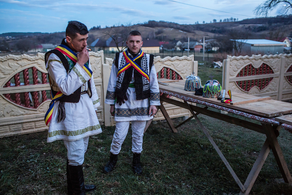 Young men dressed in traditional tsar costumes await the start of the Malanka Festival at their local commandant's house on Wednesday, January 13, 2016 in Krasnoilsk, Ukraine. The commandant is responsible for coordinating the roving group of revelers in his district. The festival will begin at sundown and last until the following evening.