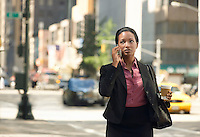Businesswoman using mobile phone in street