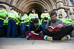 © under license to London News Pictures. 24/11/2010: Students in Manchester protest against cutbacks and the coalition government's proposed rise in tuition fees. Some students staged a sit-down protest outside Manchester Town Hall.