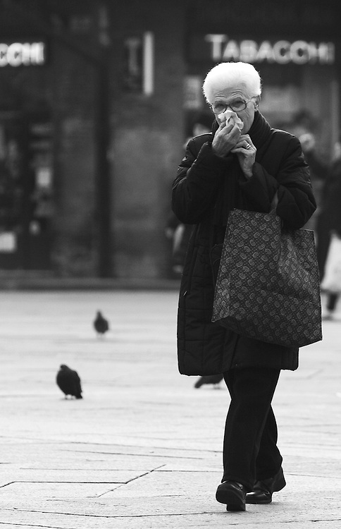"Black and white photography. Woman with cold during winter in Bologna Italy by Karl R Lilliendahl photographer.This photo is available as open edition and limited edition giclee print in four sizes. Click on ""Get Print"" to see more details."