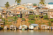 17 MARCH 2006 - KAMPONG CHHNANG, KAMPONG CHHNANG, CAMBODIA: Buildings line the riverbank of the Tonle Sap River in Kampong Chhnang in central Cambodia. PHOTO BY JACK KURTZ
