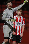 Luke Thomas and Tim Brown during the FA Trophy match between Cheltenham Town and Chelmsford City at Whaddon Road, Cheltenham, England on 12 December 2015. Photo by Antony Thompson.
