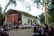 A gathering outside the chapel in Proyecto 4.