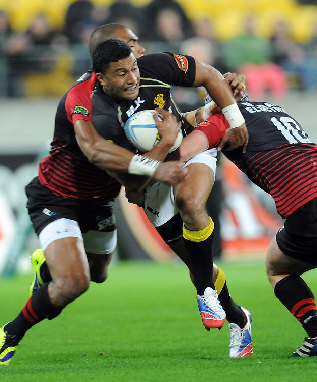 Wellingtons' Lima Sopoaga busts through theb Canterbury defence in the ITM Cup Rugby Premiership Final at Westpac Stadium, Wellington, New Zealand, Saturday, October 26, 2013. Credit:SNPA / Ross Setford