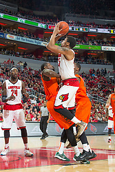 Louisville guard/forward Wayne Blackshear, right, shoots over Miami defender in the first half. <br /> <br /> The University of Louisville hosted the University of Miami, Saturday, Feb. 21, 2015 at The Yum Center in Louisville. Louisville won 55-53.<br /> <br /> Photo by Jonathan Palmer