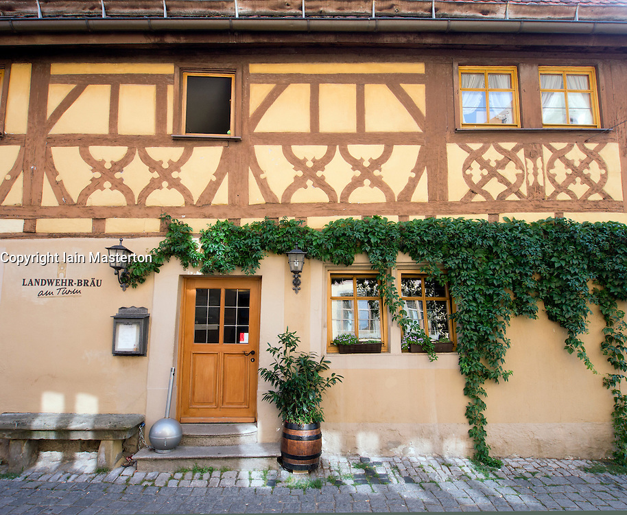 View of traditional Inn in Rothenburg ob der Tauber medieval town in Bavaria Germany