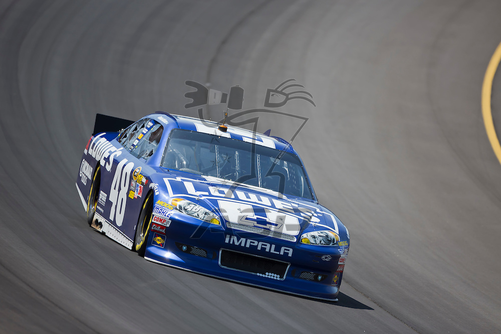 BROOKLYN, MI - JUN 14, 2012:  Jimmie Johnson (48) brings his car through the turns during the second test session for the Quicken Loans 400 at the Michigan International Speedway in Brooklyn, MI.