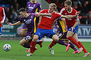 Ryan Jennings is fouled by Jim Stevenson, that ended in Harry Pell's goal during the Vanarama National League match between Aldershot Town and Cheltenham Town at the EBB Stadium, Aldershot, England on 28 November 2015. Photo by Antony Thompson.