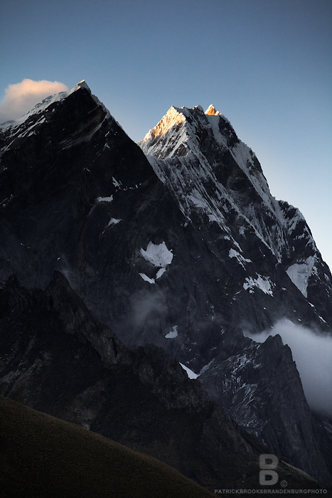First light hiting Rondoy at 5879 meter in the Cordillera Huayhuash of the Andes Mountains in Peru.