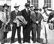 Gordon MacQuarrie, second from right, with Owen Gromme (r) and Lester Deitrich (l), Walt Petzel (second from left), all of the Milwaukee Public Museum, prior to their departure from Wisconsin to Alaska in September 1947.