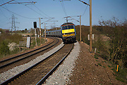 Greater Anglia Class 90 electric locomotive train on the Norwich to London line, England, UK