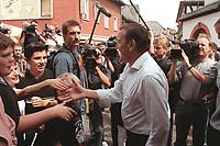 """16 JUL 1999 - UNKEL, GERMANY:<br /> Gerhard Schröder, Bundeskanzler, wird von Jugendlichen herzlich berüßt, während der SPD Radtour """"Abschied vom Rhein""""<br /> Gerhard Schroeder, Fed. Chancellor Germany, was welcomed by some young people during a trip with a part of the SPD parliamentary group to a """"Goodbye from Rhine"""" tour <br /> IMAGE: 19990716-01/08-32"""