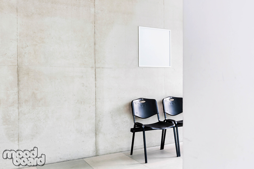 Photo of chairs in corridor at school