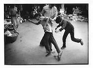 Kashmiri man breaks up fight between boys in the bazaar, Srinagar, Indian Administered Kashmir.