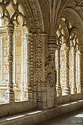 Stone pillars and cloisters of famous Monastery of Jeronimos - Mosteiro  dos Jeronimos in Lisbon, Portugal