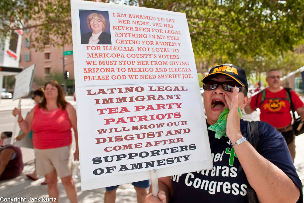 15 JULY 2010 - PHOENIX, AZ: Edwina Olivas (CQ), a member of the Tea Party from Phoenix, and a supporter of SB 1070 tries to shout down opponents of 1070 Thursday morning. People for and against SB 1070 picketed the front of the Sandra Day O'Connor US Courthouse (CQ) in Phoenix Thursday morning during the first hearing against SB 1070.     PHOTO BY JACK KURTZ