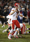 Kansas City Chiefs quarterback Alex Smith (11) scrambles away from a player who pulls on his jersey as he throws a fourth quarter pass during the NFL week 12 regular season football game against the Oakland Raiders on Thursday, Nov. 20, 2014 in Oakland, Calif. The Raiders won their first game of the season 24-20. ©Paul Anthony Spinelli