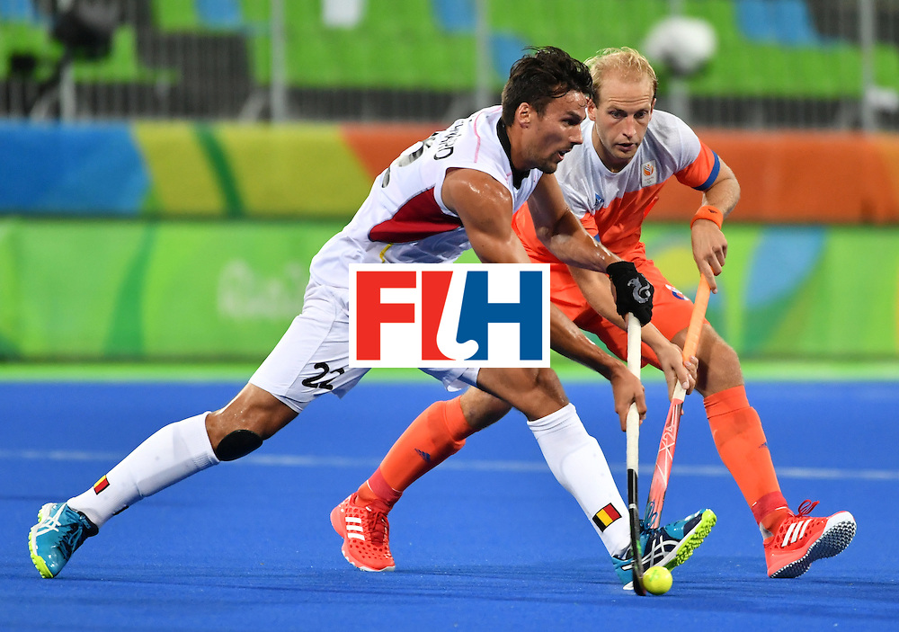 Belgium's Simon Gougnard (L) vies with Netherland's Billy Bakker during the men's semifinal field hockey Belgium vs Netherlands match of the Rio 2016 Olympics Games at the Olympic Hockey Centre in Rio de Janeiro on August 16, 2016. / AFP / Pascal GUYOT        (Photo credit should read PASCAL GUYOT/AFP/Getty Images)