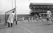 Cork player tackles Sligo player mid air during the All Ireland Minor Gaelic Football Final Sligo v. Cork in Croke Park on the 22nd September 1968. Cork 3-5, Sligo 1-10.