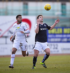 Inverness Caledonian Thistle's Jordan Roberts and Dundee's Gary Irvine. <br /> Half time : Dundee 0 v 1 Inverness Caledonian Thistle, SPFL Ladbrokes Premiership game played at Dens Park, 27/2/2016.