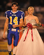 Oxford High's Toler Presley (14) escorts junior maid Eloise Tyner during Homecoming of the Oxford vs. Hernando in Oxford, Miss. on Friday, October 14, 2011. Hernando won 31-30 in overtime.