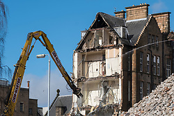 Demolition work on old Western Infirmary hospital in Glasgow West End , Scotland, United Kingdom