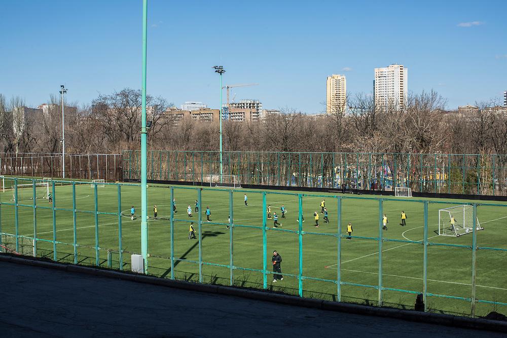 Children play soccer on Friday, April 10, 2015 in Donetsk, Ukraine.