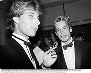 Damian Aspinall and Andrew de Candole. Howell and Chalmers dance for Serena and Sophie at the Hurlingham Club. London. 10/9/82. Film 82920f9<br />