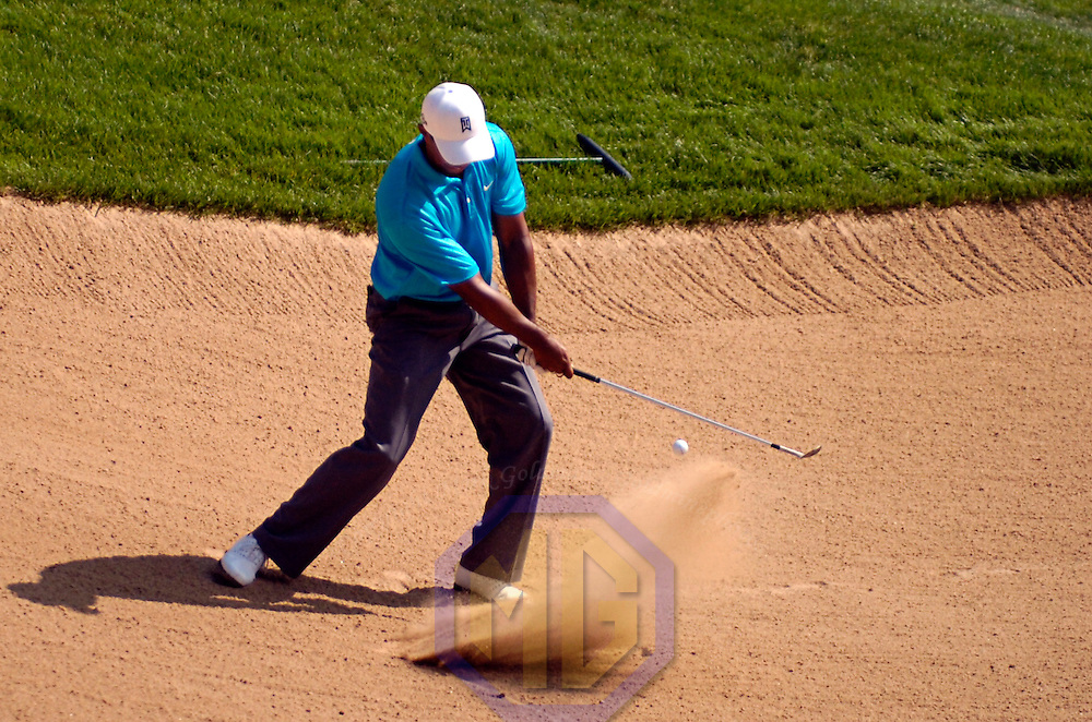 06 July 2007:  Tiger Woods chips out of a sand trap on the 15th hole  in the second round of the inaugural AT&T National PGA event at Congressional Country Club in Bethesda, Md.  ****For Editorial Use Only****