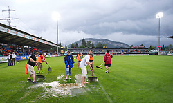 ALTACH, AUSTRIA - Saturday, July 17, 2010: Workers frantically try to remove water from the pitch with snow shovels and brushes before Liverpool's first preseason match of the 2010/2011 season  against Al-Hilal Al Saudi FC at the Cashpoint Arena. (Pic by David Rawcliffe/Propaganda)