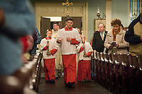 Altar servers and clergy entered mass down the main aisle at the Shrine of St. Ferdinand on the feast of St. Rose Phillipine Duchesne.  LISA JOHNSTON/lisajohnston@stlouisreview.com