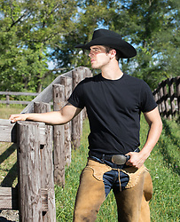 hot cowboy in chaps on a ranch