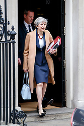 © Licensed to London News Pictures. 26/04/2017. London, UK. Prime Minister THERESA MAY leaves Downing Street to attend Prime Minister's Question Time in House of Commons in London on 26 April 2017. Photo credit: Tolga Akmen/LNP