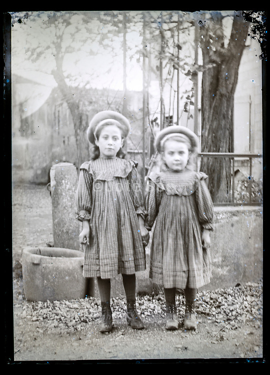 two little girls wearing identical clothing France ca 1920s