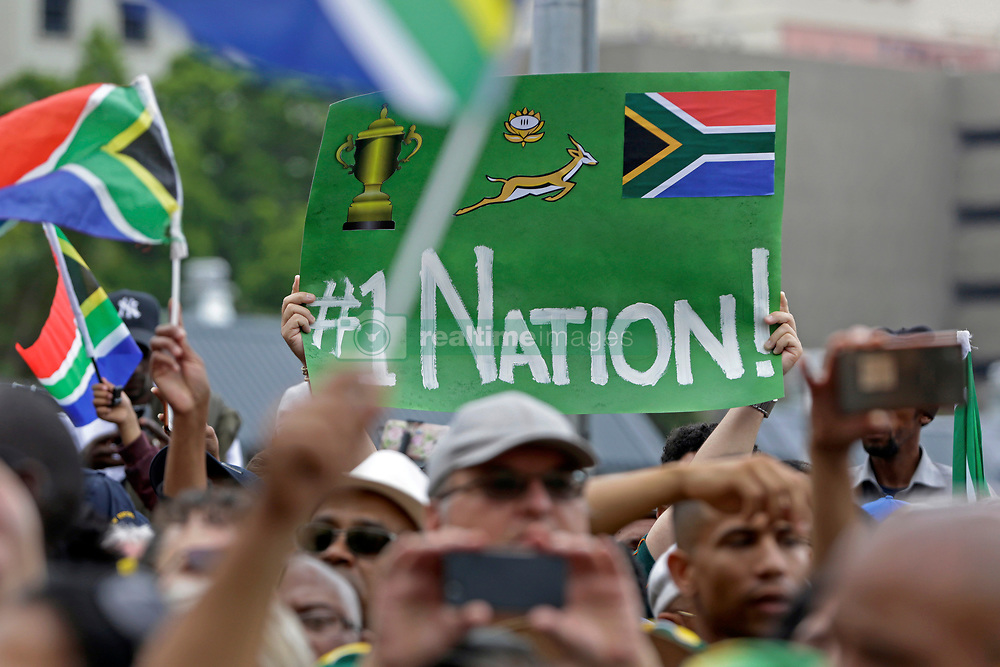 Monday 11th November 2019.<br /> City Hall, Grand Parade,<br /> And City Centre, Cape Town,<br /> Western Cape,<br /> South Africa.<br /> <br /> SPRINGBOKS CELEBRATE WINNING THE RUGBY WORLD CUP CHAMPIONSHIP IN 2019 WITH A COUNTRYWIDE VICTORY TOUR!<br /> <br /> SPRINGBOKS RUGBY WORLD CUP VICTORY TOUR CAPE TOWN!<br /> <br /> A  Springbok fan holds up a poster proclaiming South Africa and the Springboks as the best nation as thousands of other excited fans wait on Cape Town's Grand Parade for the Springboks to arrive.<br /> <br /> The reigning Rugby World Cup Champions namely the South African Springbok Rugby Team, celebrates winning the Webb Ellis Cup during the International Rugby Football Board Rugby World Cup Championship held in Japan in 2019 with their Victory Tour that culminated in the final city tour taking place in Cape Town. Thousands of South African fans filled the streets of the city all trying their best to show their support for their beloved Springboks and to celebrate them winning the Rugby World Cup for the third time. South Africa previously won the Rugby World Cup in 1995, 2007 and now again in 2019. South African Springbok Captan Siya Kolisi took the opportunity to speak to the gathered crowd about how something like this brings unity and that we should live together as a nation that practices what is known as ubuntu. Ubuntu is a quality that includes the essential human virtues of compassion and humanity. This image taken in Cape Town on Monday 11th November 2019.<br /> <br /> This image is the property of Seven Bang Media Group (Pty) Ltd, hereinafter referred to as SBM.<br /> <br /> Picture By: SBM / Mark Wessels. (11/11/2019).<br /> +27 (0)61 547 2729<br /> mark@sevenbang.com<br /> www.sevnbang.com<br /> <br /> Copyright © SBM. All Rights Reserved.
