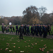 Police following a small group of students through Horse Guard parade and St James' Park. Thousands of students turned out to a march against fees and cuts in the education sector, calling for workers ans students to unite againts the Government's austerity policies.