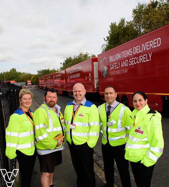 Pictured is, from left, Emily Scott Yorkshire Distribution Centre (YDC) head of ops, driver Ryan Doyle, Steven Edgley, YDC plant manager, Steve Thompson, YDC head of distribution, and Sally Warren, area distribution manager - North region, with the double decker trailers.<br /> <br /> Royal Mail is rolling out 400 new double decker trailers (called 95's), which feature a rising platform to provide two layers of storage.   They are currently used for transporting Yorks, but at the end of October, Yorkshire Distribution Centre is going to use them to loose load 16,000 packages - double the current capacity of the single trailers.<br /> <br /> Picture: Chris Vaughan Photography<br /> Date: October 17, 2016