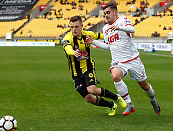 The Phoenix's Scott Galloway, left and Adelaid United's Benjamin Garuccio contest the ball in the A-League football match at Westpac Stadium, Wellington, New Zealand, Sunday, October 08, 2017. Credit:SNPA / Dean Pemberton **NO ARCHIVING**