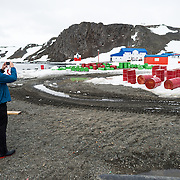 Tourists arriving at Base Presidente Eduardo Frei Montalva on King George Island in Antarctica. The base is the most important of Chile's Antarctic scientific research bases and also has an airstrip that is available to tourist charter flights.