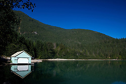 Boat house and reflection along the shore of Lake Diablo, North Cascades National Park, Washington, United States of America