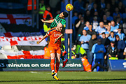 Coventry City defender Jordan Willis (4) and Luton Town forward Danny Hylton clash in the air during the EFL Sky Bet League 1 match between Luton Town and Coventry City at Kenilworth Road, Luton, England on 24 February 2019.